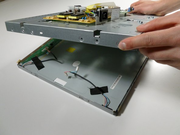 Image 1/3: Turn the display over to see the front; you are ready replace the broken display with a new one!