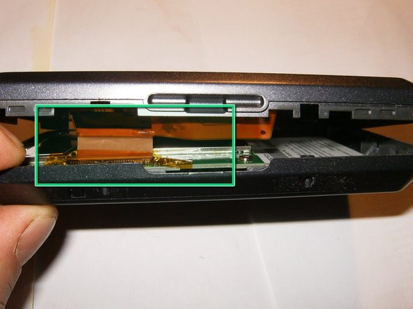 Once the front and back case are split, do not yet totally remove it. The LCD is still attached via a ribbon cable.