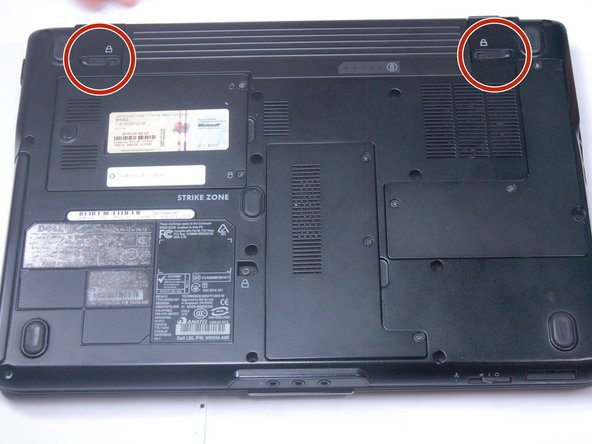 Image 1/1: After flipping over the laptop, the battery is on the bottom side of the laptop.