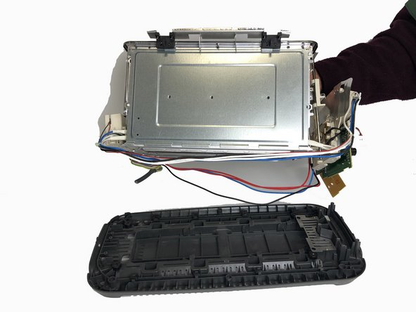 Separate the interior body of the toaster from the bottom cover.