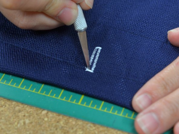 Use a hobby knife to cut open the buttonhole.