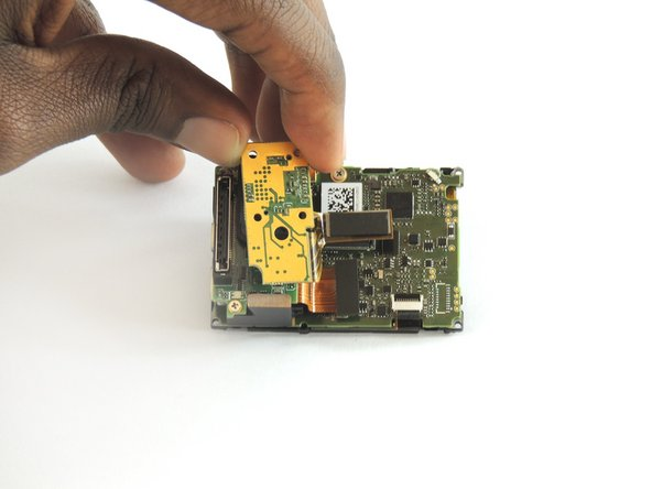 Using a #00 Phillips head screwdriver, remove the four 3.0mm screws holding the camera sensor.