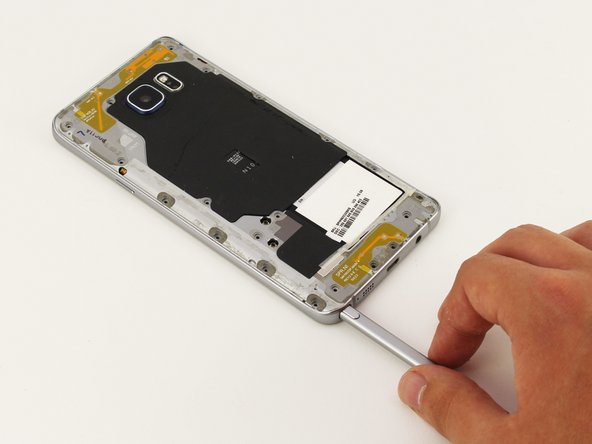 Remove the S-Pen from the bottom of the device.