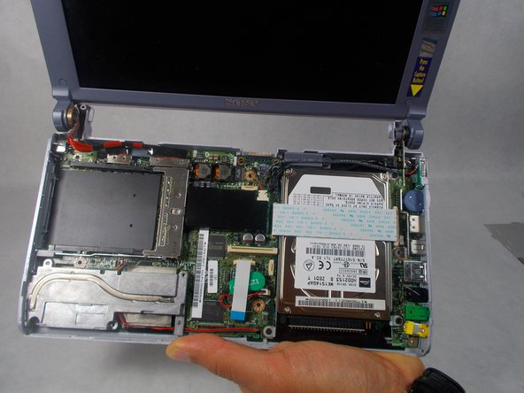 There are no longer any wires connecting the casing to the motherboard. The casing can be fully removed and put to the side.