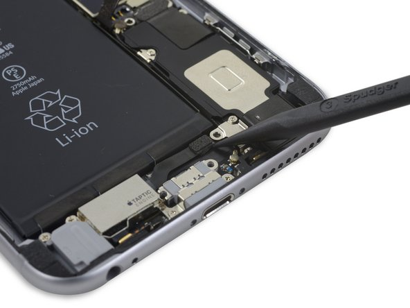 Disconnect the Taptic Engine's flex cable  from the socket on the Lightning Connector flex cable.