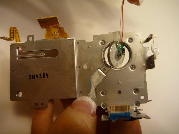 Image 2/3: Remove speaker from holding dock.