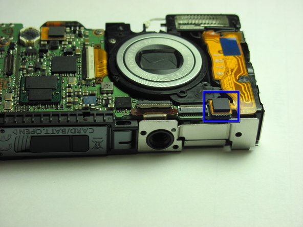 Disconnect the connector at the bottom of the camera that attaches the flash to the motherboard by gripping it with you fingers and flipping it up.