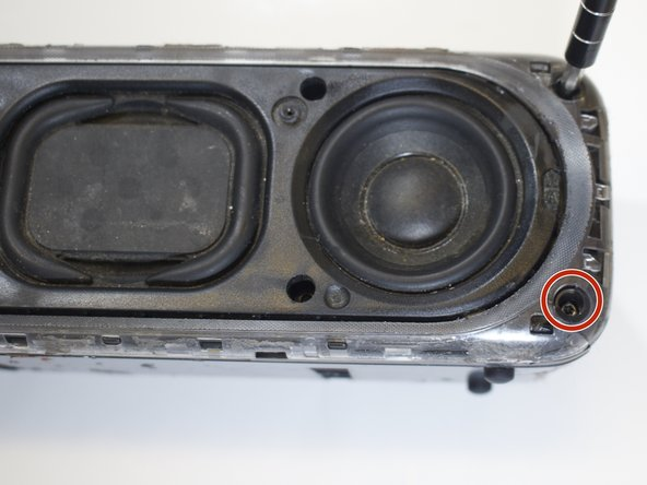 Next, remove the four outer edge screws, located on each corner of the speaker. The outer edge of the speaker is a clear plastic.