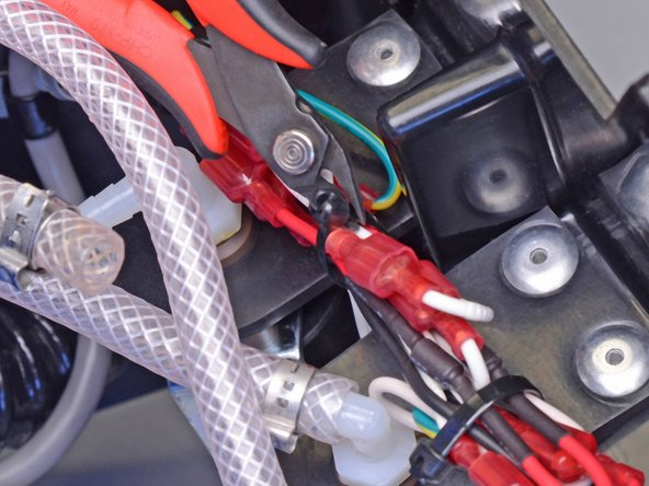 Cut the zip ties holding the bundle of wires together.