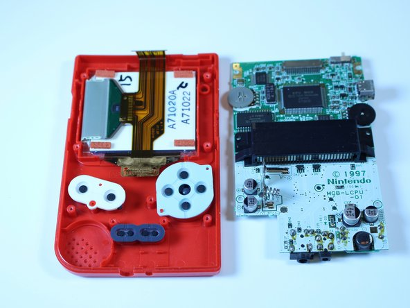 Image 2/3: Set the motherboard aside. You will need it to reassemble the device.