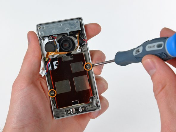 Image 1/3: Use a plastic opening tool to pry the battery up off the outer case.