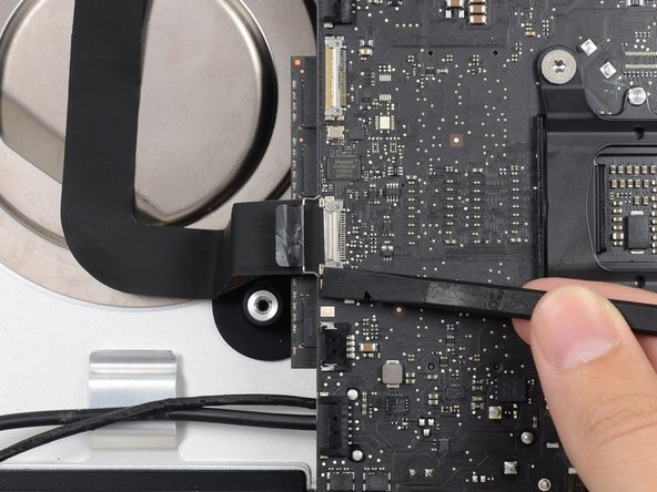 Pull the iSight camera cable straight out of its socket on the logic board.