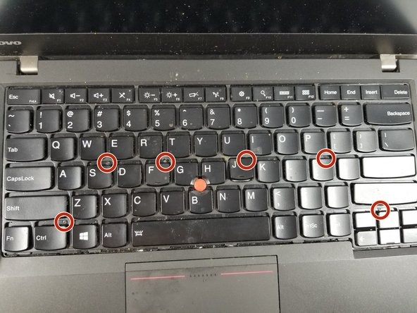 Use a Phillips #00 screwdrivers to remove the six screws holding in the keyboard.