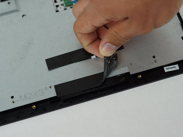 Very carefully remove the black tape holding the metal plate in place.