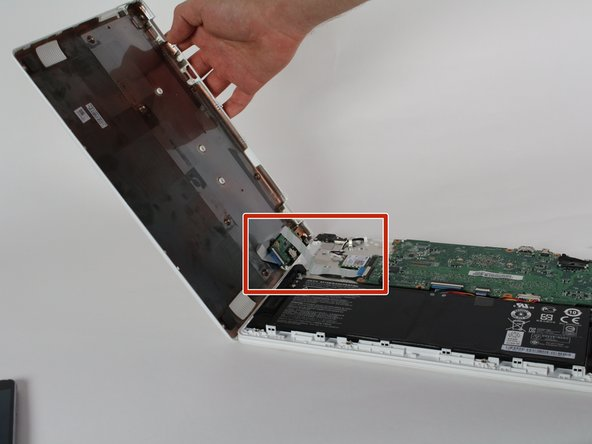 Use the plastic opening tool to pry open then remove the plastic base from the rest of the laptop. Start from the right side and work towards the left.