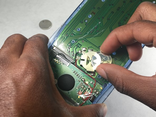 Remove the old battery and insert the new battery.