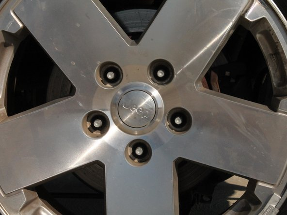 Image 1/2: Pull straight out and off in order to not damage any of the wheel studs that the wheel is resting on.