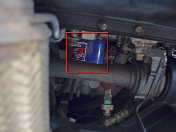 The engine oil filter is located on the back of the engine, almost directly above the drain plug.