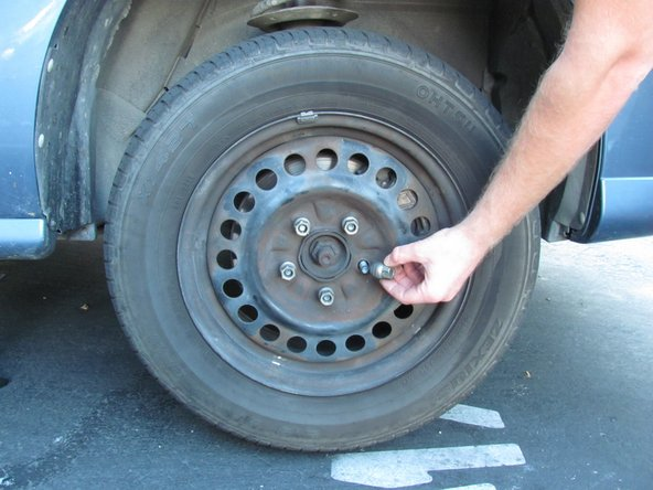 Image 2/2: Torque the metal lug nuts to 100 ft-lbs when putting the wheels back on the car.
