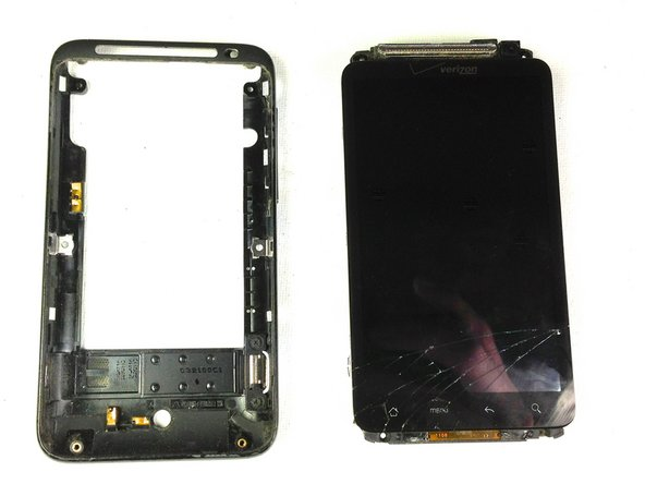 Gently pull down on the phone and screen to fully separate it from the rear frame.