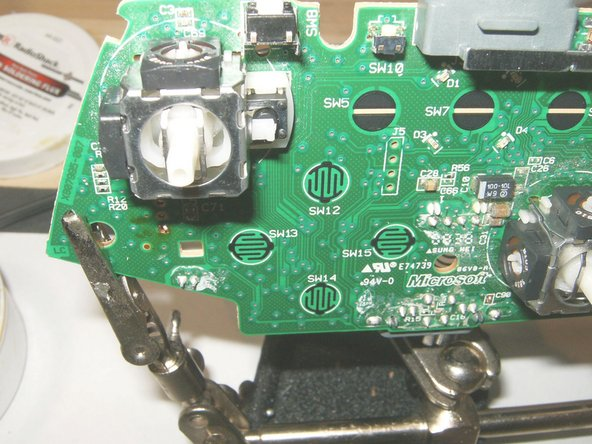 Put the new 3D analog stick in place. Make sure that it is seated flush against the board.