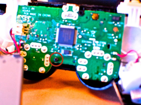 Don`t forget to insert the screw (circled in red) holding the motherboard to the control panel.