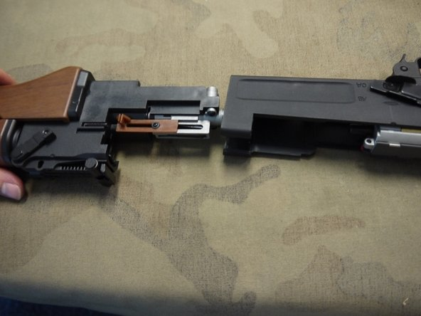 Pull the barrel assembly out of the receiver.