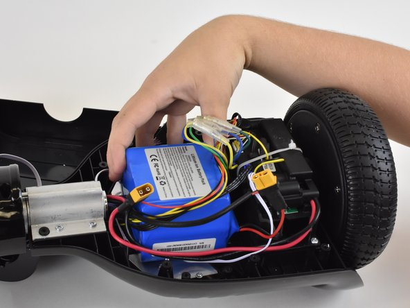 Pull on the battery until it separates from the hover board. You may need to use some force.