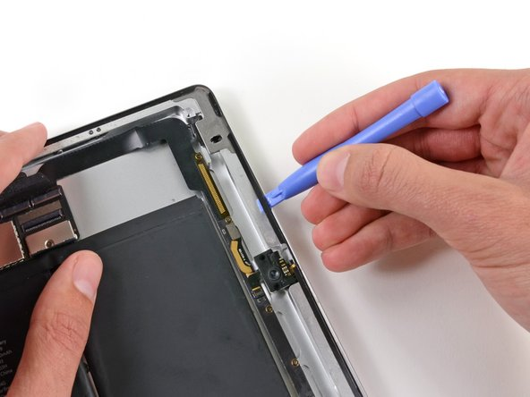 Be mindful of the front facing camera when sliding the plastic opening tool along the top edge of the iPad.
