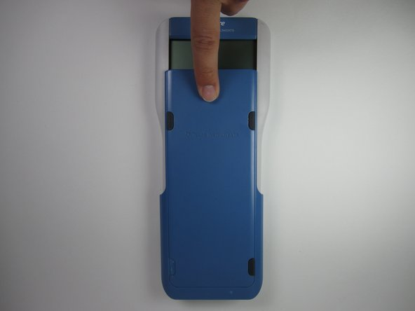 Slide the blue cover downwards until it is completely removed from the calculator.