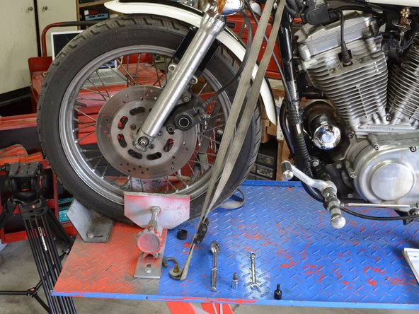 If you do not have a motorcycle lift, you will still be able change the brake pads, but it is still a good idea to secure the front wheel in place.