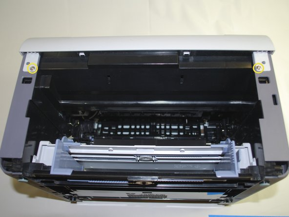 "Using a Phillips #2 screwdriver, remove the two, 1"", Phillips, PH#2 screws on the front face of the printer."