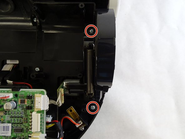 Remove the two 5mm Phillips #1 screws in the holes closest to the right wheel.