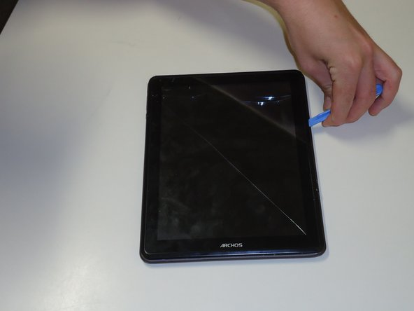 To start, lay your tablet upwards facing you. Begin to pry your tablet open in the corner using a prying tool. Start in the top left corner, near the volume and power button, working your way around clockwise.