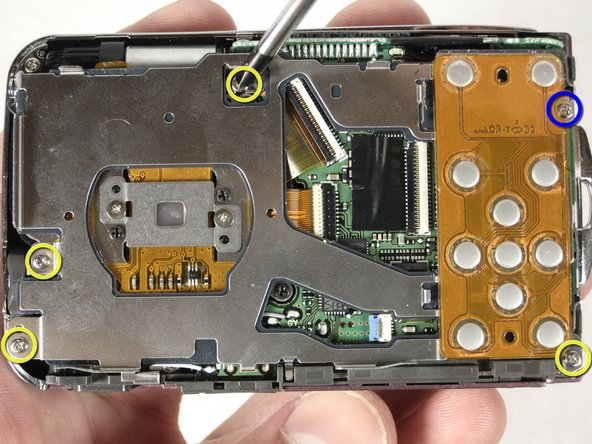 After removing the LCD screen, unscrew the four 3.8mm screws that hold down the metal plate