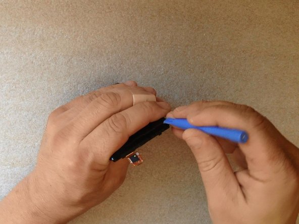 Image 1/3: By using plastic tools gently start separating.