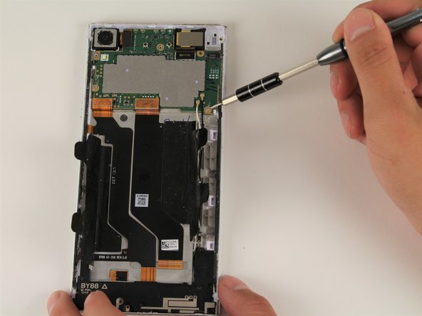 Remove the two 4mm T5 screws connecting the motherboard to the device.