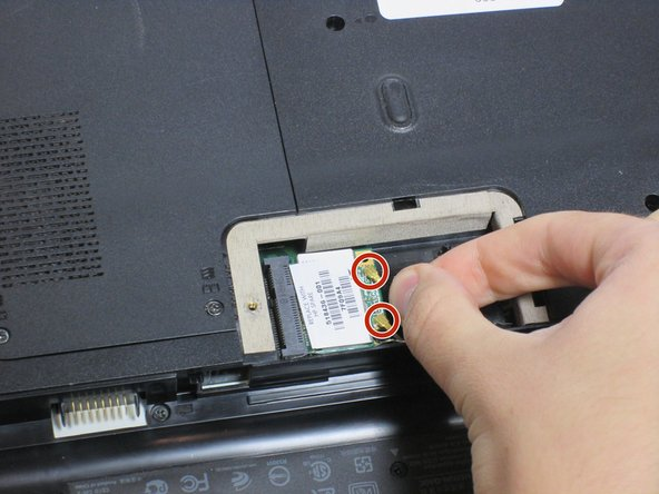Image 1/3: Remove the 3mm screw holding the Wi-Fi module using a Phillips #0 screwdriver.