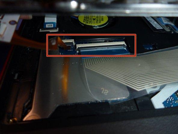 Image 1/3: The thin orange cable is the RGB led keyboard retro illumination.