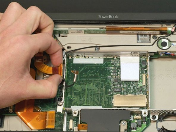 PowerBook being fixed with the help of iFixit Answers