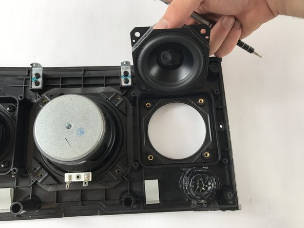 Remove the right mid-range speaker buy pulling up and away from the front panel.