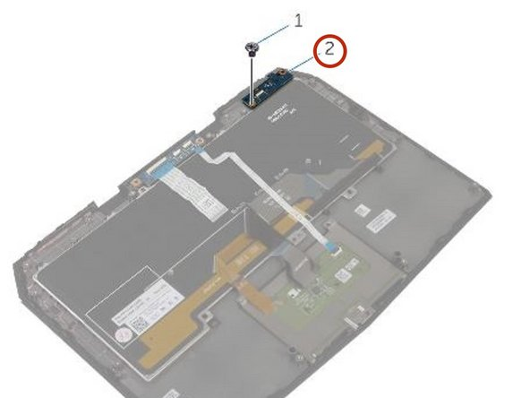 Remove the screw that secures the status-light board to the palm-rest assembly.