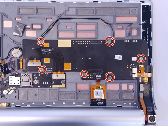 Remove the six 3mm screws on the back of the motherboard with the Phillips Screwdriver #00 bit.