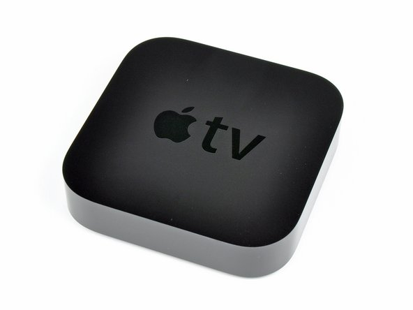 Image 2/3: As a rare treat, Apple has decided to bundle an Apple Remote with the Apple TV.