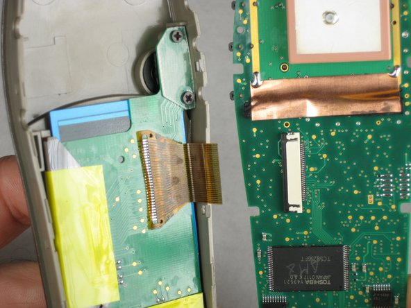 Image 2/2: Gently pull the wire ribbon from the white connector.