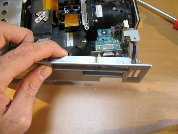 To remove the side panel of the case- gently pry around the corners until removed