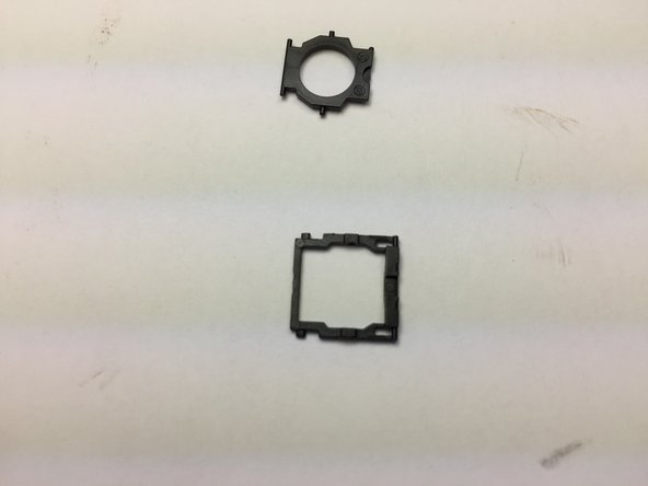 Take both pivoting pieces of the mechanism and put them together. The smaller piece fits through the inner part of the larger piece and lays in the grove of the larger piece. Once assembled it should be entirely flat.