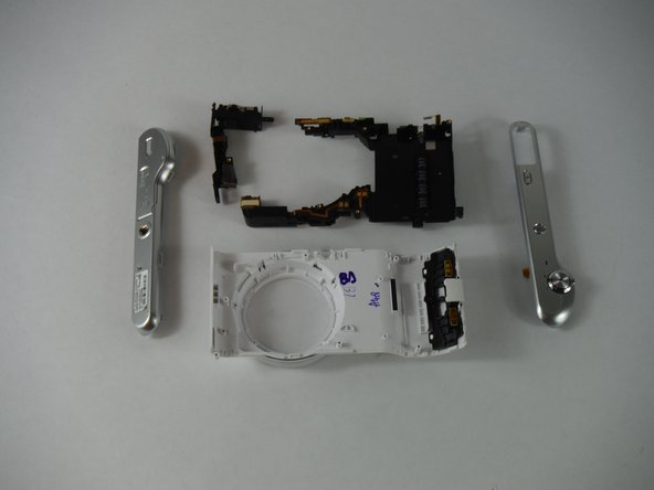 Next, gently use the plastic opening tool to pry the black frame out of the casing. The frame should lift out easily. If you feel some resistance, you may have missed a screw.