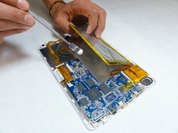 Using a plastic opening tool or spudger, slowly pry the battery away from the board.