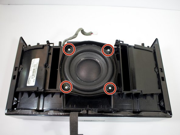 Remove the four 19 mm PH2 screws holding the subwoofer in place.